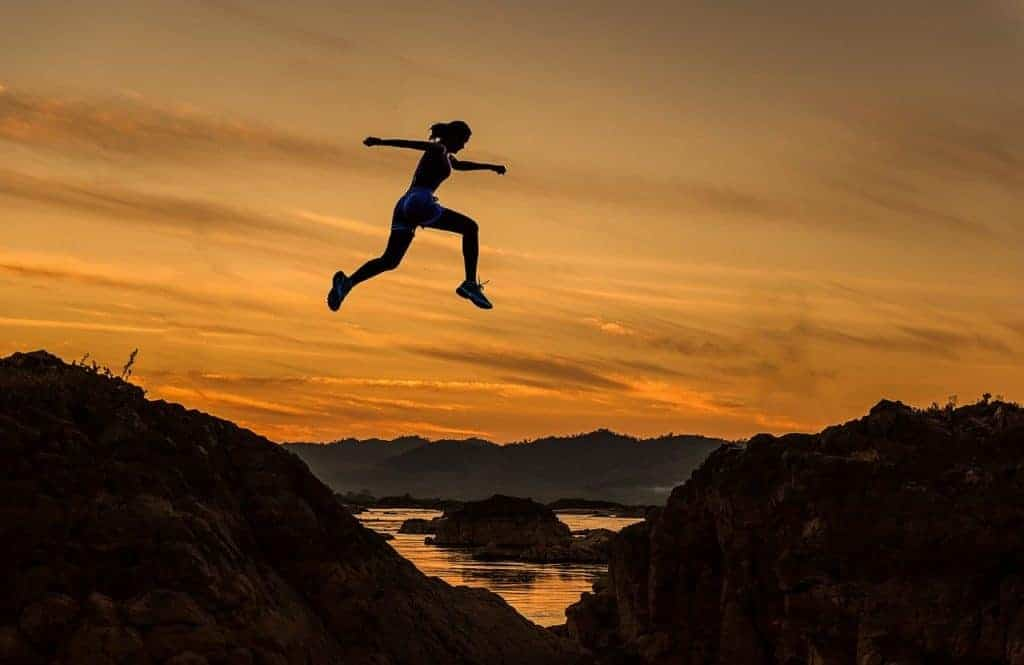 Woman leaping for Leap Year 2020